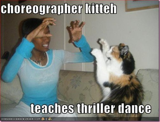 funny-pictures-choreographer-cat-teaches-thriller-dance