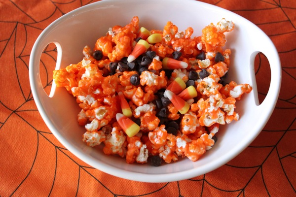 Candy corn popcorn with more candy corn and chocolate chips!