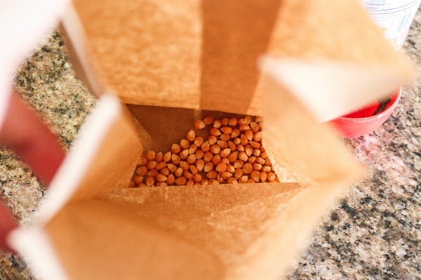Popcorn kernels in a brown bag