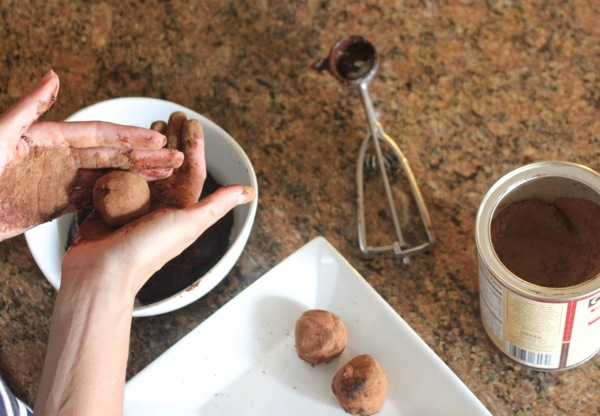 Rolling the raw cashew brownie batter truffles