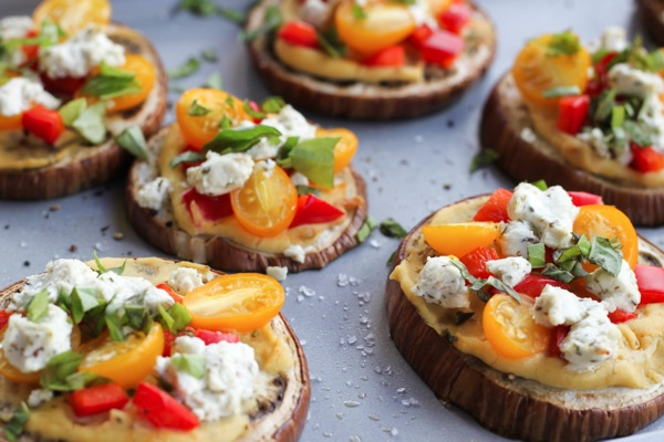 Eggplant pizzas with goat cheese, tomatoes and basil