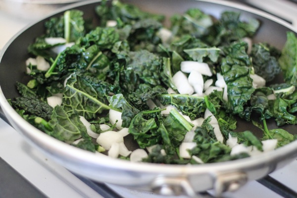 Kale, spinach and onion cooking