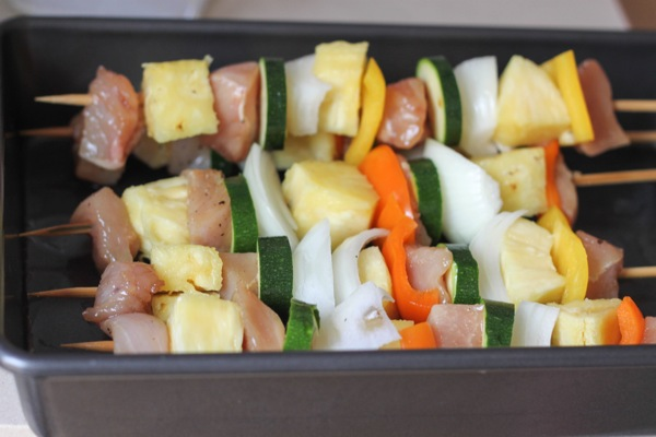 pineapple chicken and veggie kabobs ready for the grill