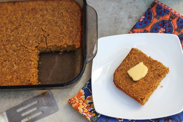 a slice of pumpkin cornbread with vegan butter