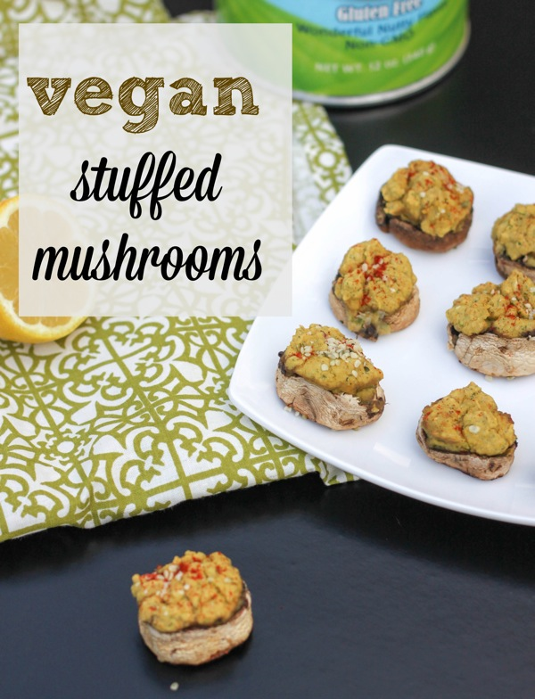 "These vegan stuffed mushrooms are hearty and ""cheesy"" thanks to chickpeas and nutritional yeast in the filling. They are the perfect vegan appetizer for the holidays! #veganappetizer #veganstuffedmushrooms 
