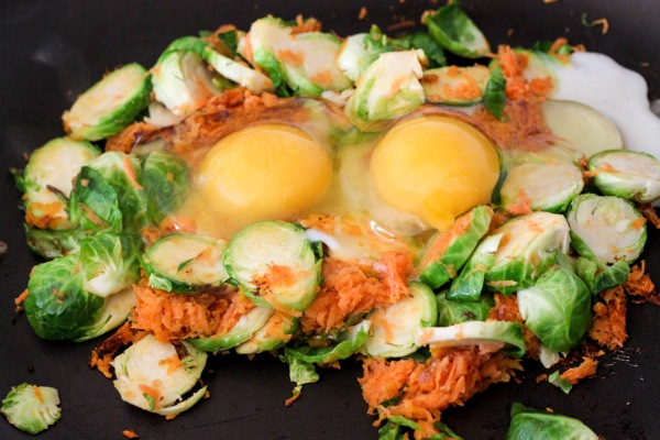Crack the eggs in the middle of veggies