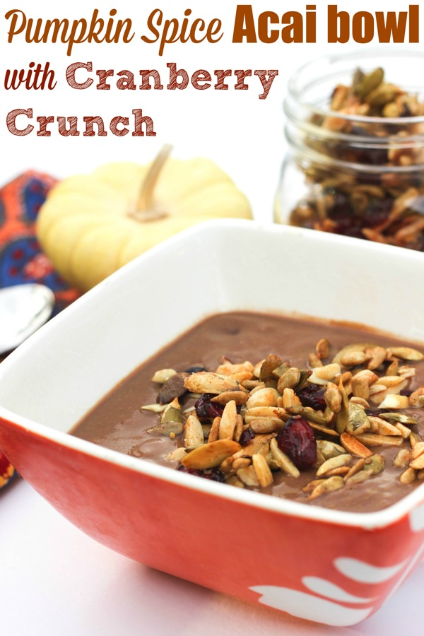 Pumpkin Spice Acai Bowl with Cranberry Crunch! A twist on the beloved acai bowl using holiday flavors. Pumpkin makes it a perfect Thanksgiving breakfast idea or satisfying snack option. Grain-free, vegan and easy to make. fitnessista.com