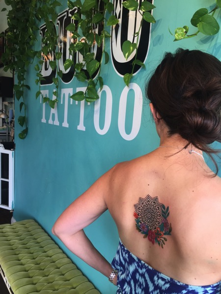 Mandala tattoo with watercolor flowers