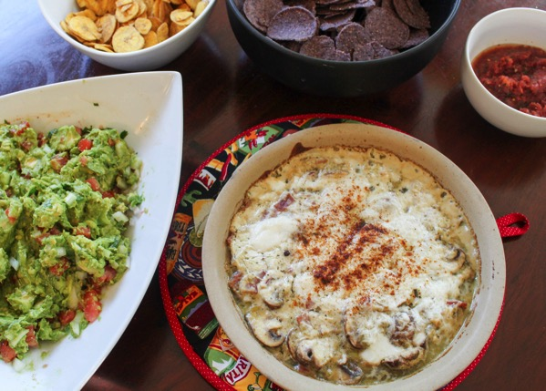 Chips with goat cheese dip, guacamole and salsa