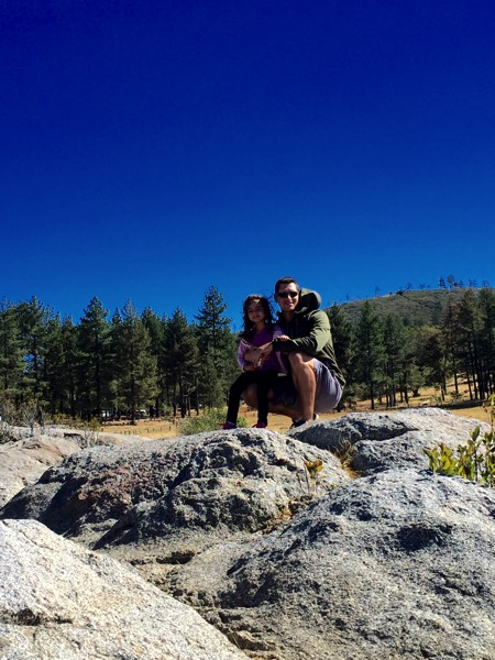 Liv and the Pilot at the top of a rock