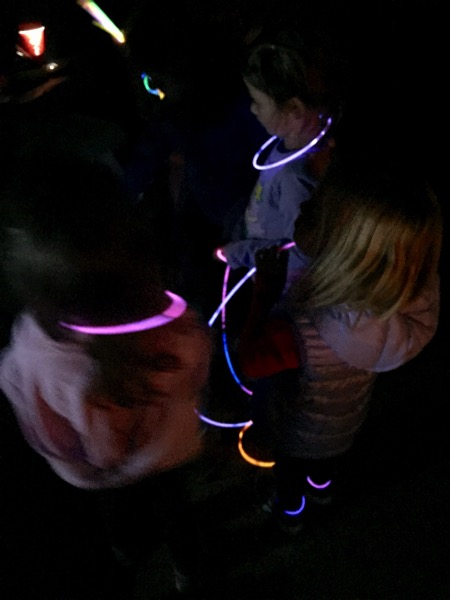 wearing glow sticks for camping fun