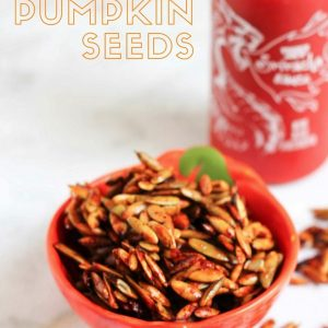 A super healthy snack recipe: honey sriracha pumpkin seeds! Spicy with a sweet kick. Check out the recipe on fitnessista.com