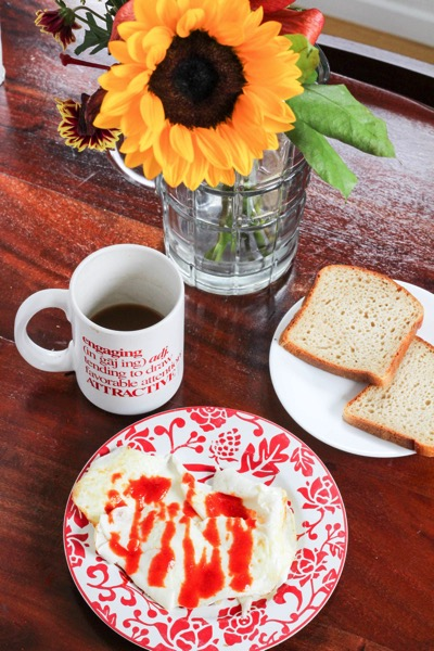 Scrambled eggs with gluten-free toast and coffee