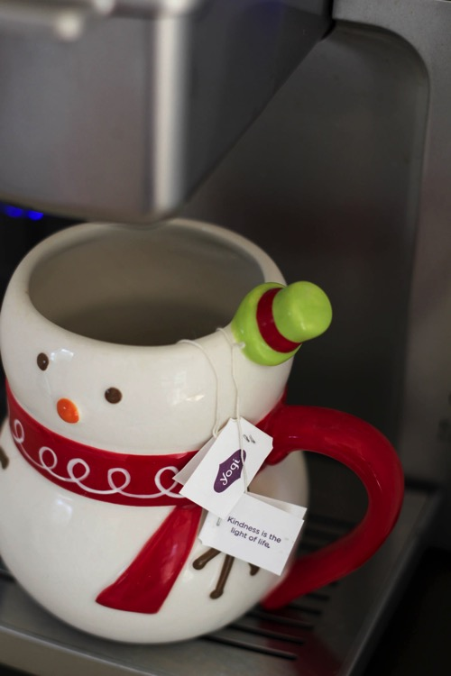 Green Tea in a snowman mug