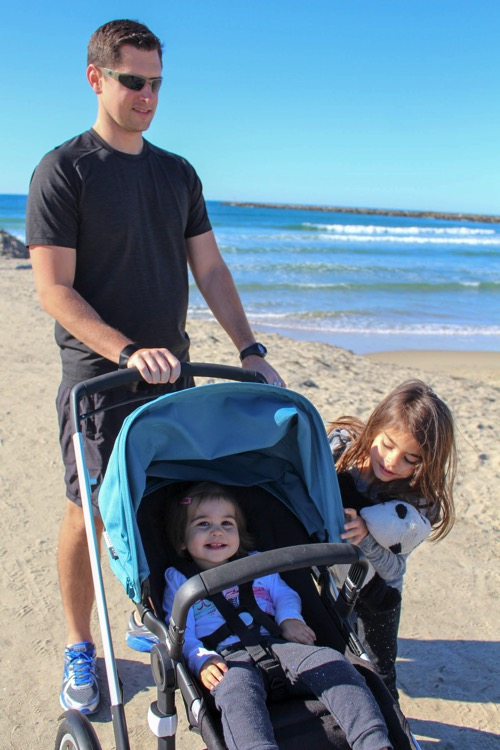 Tom and the girls with Bugaboo at the beach