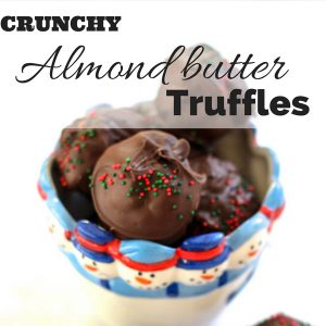 Crunchy almond butter truffles! Are you looking for a healthier but still delicious option for holiday cookies? These are a decadent holiday treat without added refined sugars. Crunchy almond butter truffles are coated with rich chocolate, and have an awesome crunch from puffed rice cereal. You need these in your life.