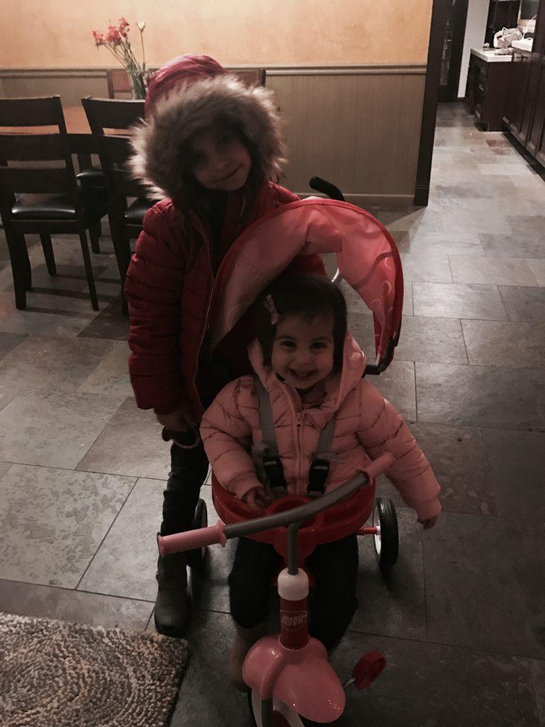 P in her trike, Livi in her furry coat