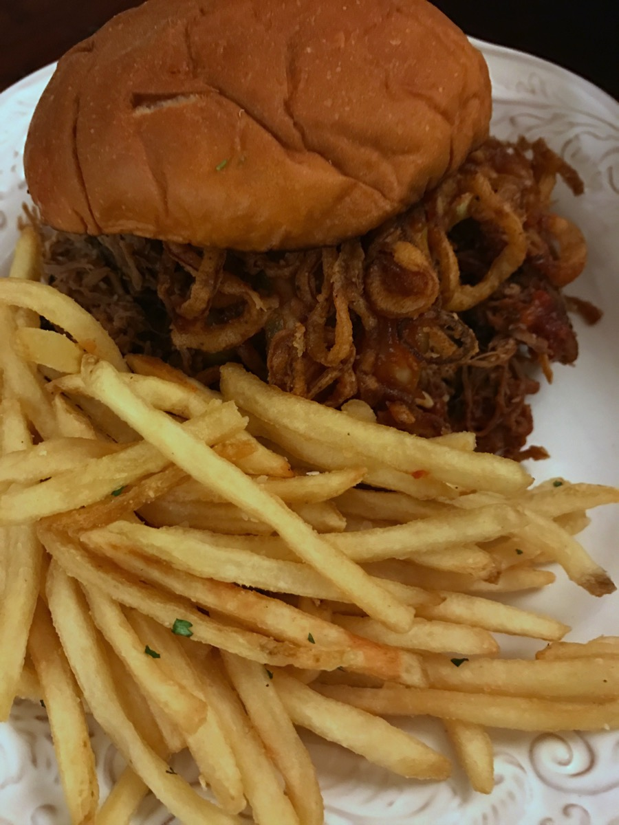 Pulled pork sandwich with fries