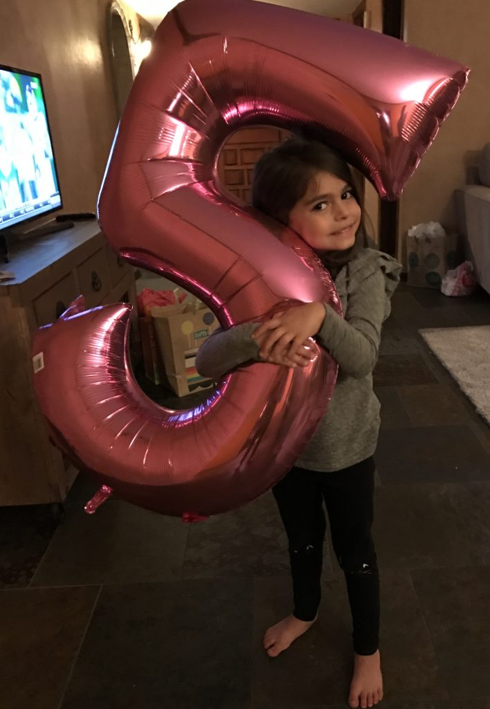 "Liv hugging her ""5"" balloon"