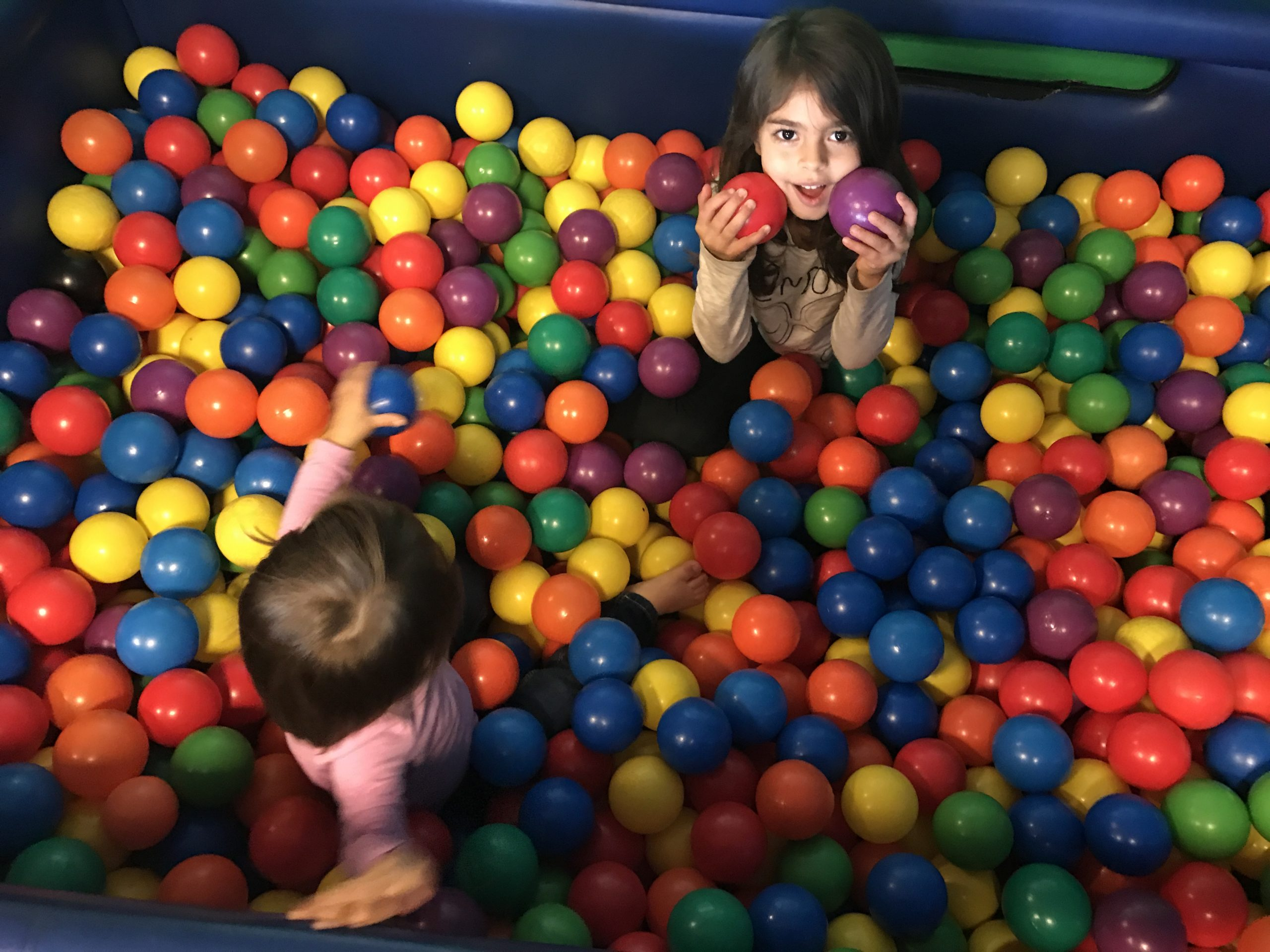 the girls in the ball pit