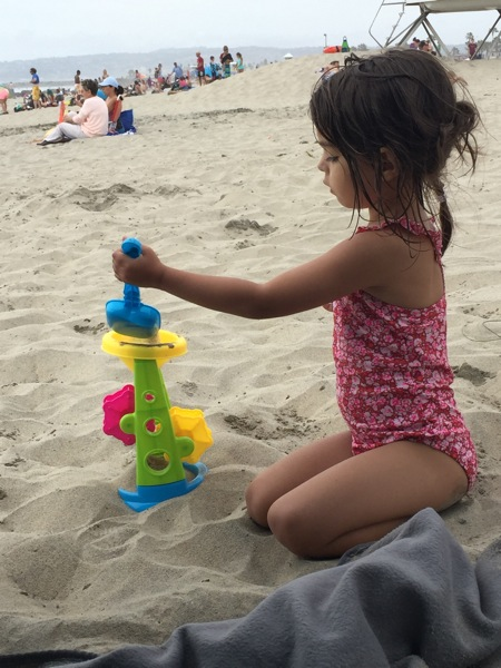 Liv playing in the sand