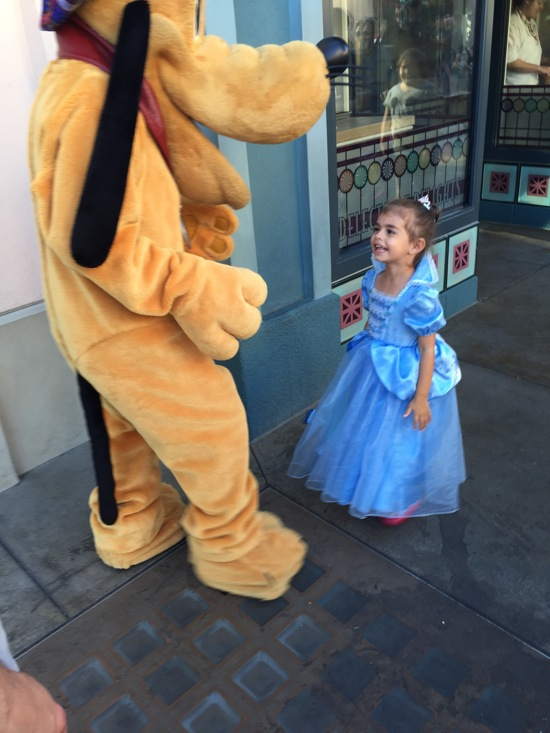 Liv at Disneyland with Pluto