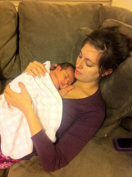 Me and newborn Liv snuggling on the couch
