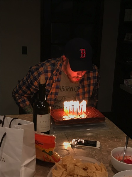Kyle blowing out candles