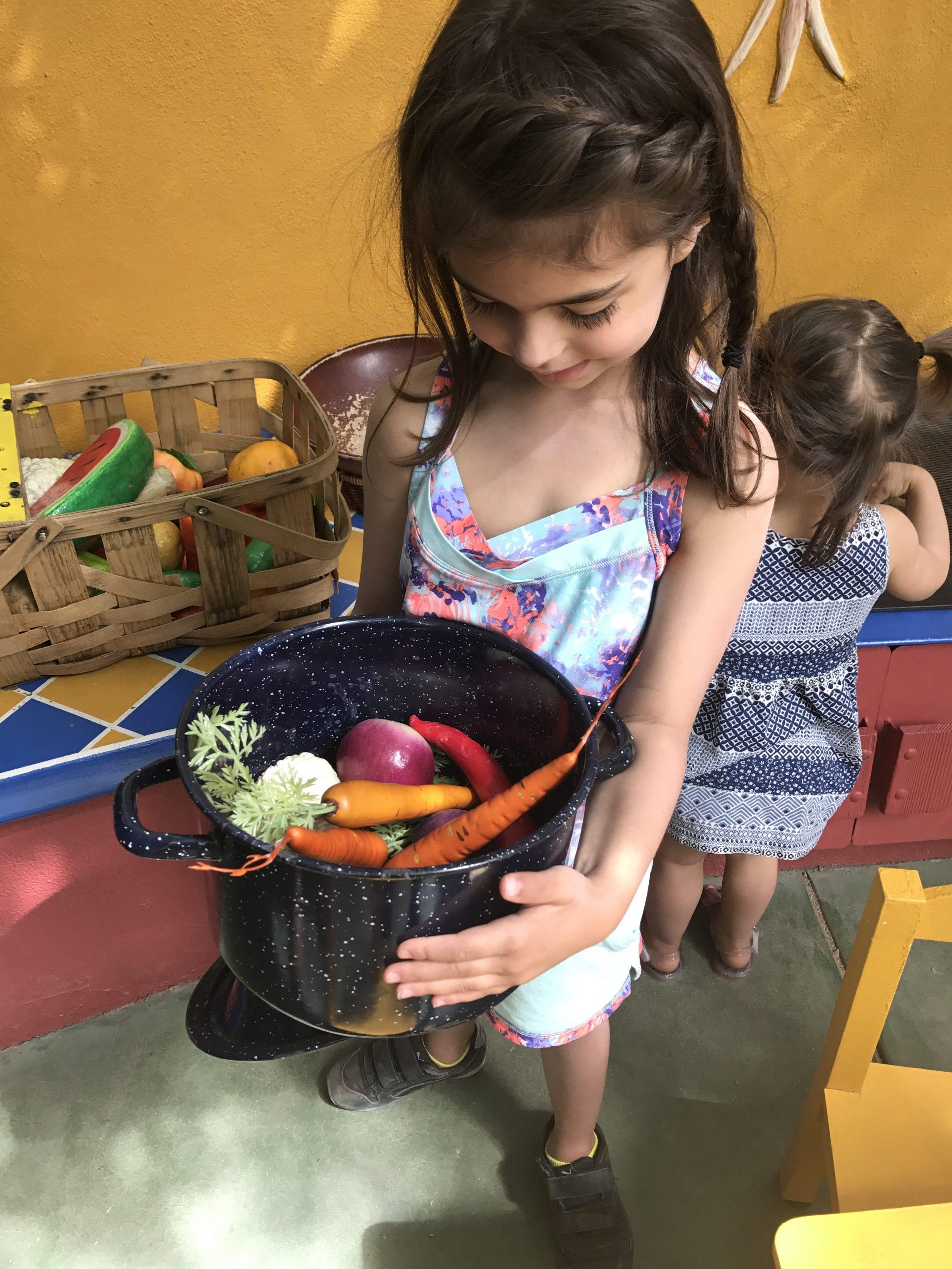 Liv playing kitchen