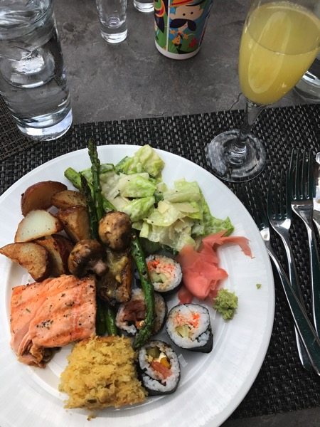 Brunch plate loaded with veggies, potatoes, sushi, salmon