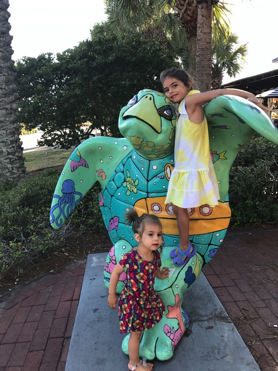 Girls on a turtle statue