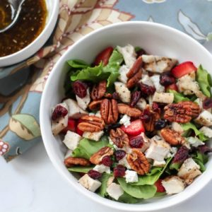 grilled chicken salad with maple-roasted pecans and strawberries