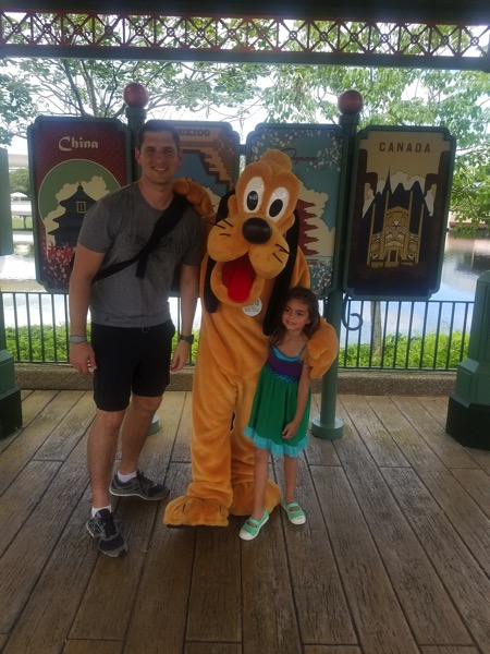 Tom and Liv with Pluto