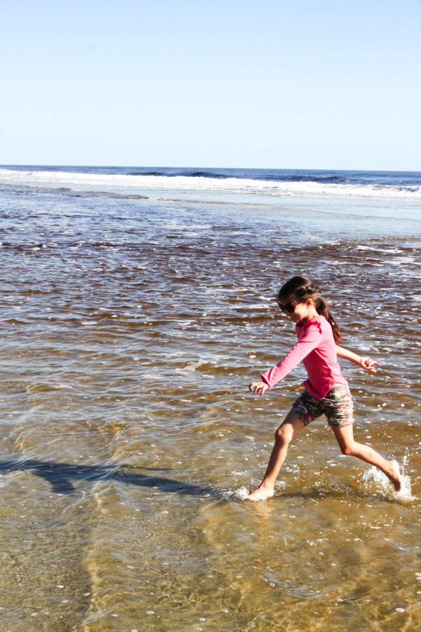 Liv running in the water