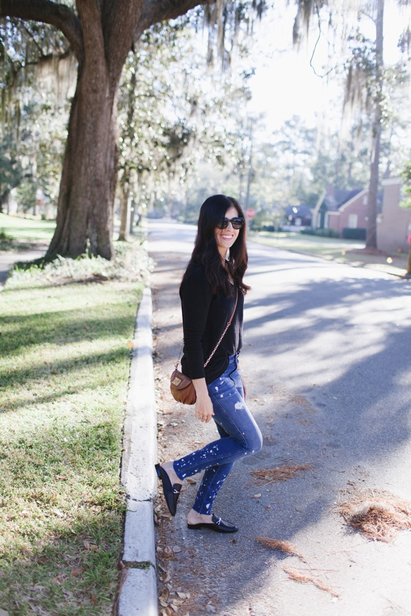 2017 Fall street style. Classic v-neck sweater, high rise jeans and black mules