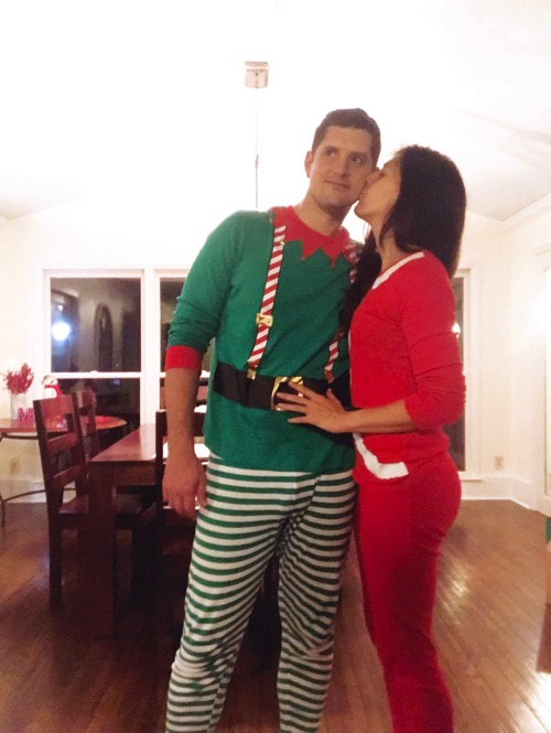 Me in my Santa jammies kissing Tom in his Elf jammies