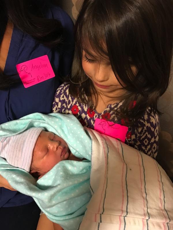 Livi holding Everly