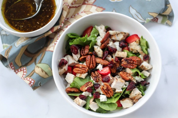 Grilled chicken salad with maple roasted pecans and strawberries