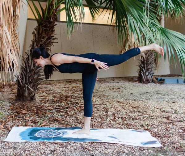 Girl going warrior 3 yoga