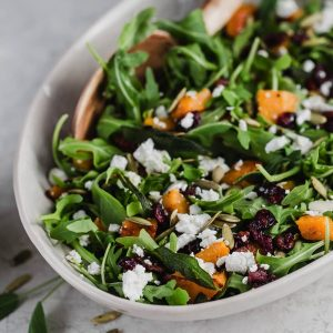 This fall salad has butternut squash, spicy arugula, a tangy vinaigrette, chicken, pumpkin seeds, goat cheese. It's perfect for any holiday gatherings or parties and makes a veggie-packed side dish. My vegetarian friends can easily omit the chicken and it's just as delicious without it. fitnessista.com
