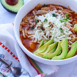 Chicken tortilla soup in the Instant Pot only using 6 ingredients. Gluten-free, packed with protein, and the whole family will love it. Fitnessista.com