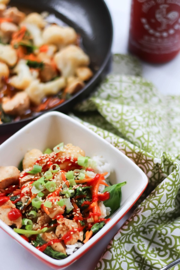 This sriracha chicken and cauliflower stir fry is the perfect healthy dinner or lunch option. It's high in protein, gluten-free, dairy-free, and family-friendly. Pack up the extras as lunch, or enjoy as part of your weekly meal prep. fitnessista.com